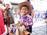 """A cute little guy giving out """"roscas"""" during the desfile"""