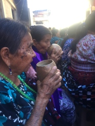 Las ancianas drinking San Pedro-style atol during a church ceremony